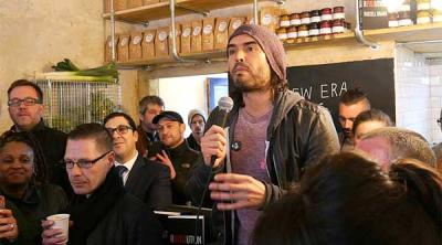 Russell Brand opens the Trew Era Cafe in East London