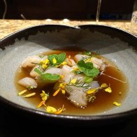 Wild scallop, mustard flower and marigold in a roasted Jerusalem artichoke broth
