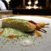 Halibut cooked in bread, prawn sauce, Cornwall carrots, whey sauce and sea lettuce from Cornwall