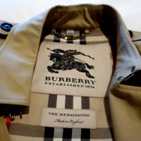 The Burberry coat in the room to help cope with British weather