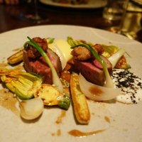 Cornish lamb with sheep's milk, courgette, onions and creamed potato