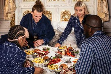 Burger and Lobster are serving up a caviar and lobster dinner in a gold four poster bed. For real.