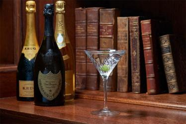 The Library Bar at The Ned offers a martini trolley alongside truffle pizzas