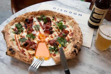Behold the Dishoom Bacon and Egg Naan Pizza Pilgrims pizza