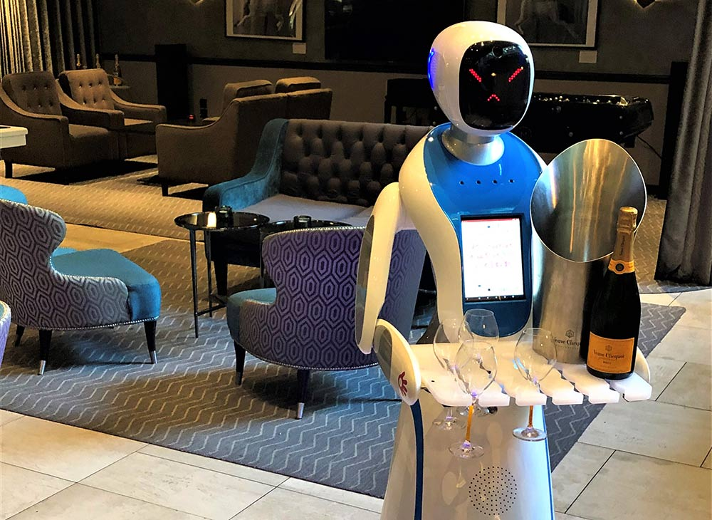 Is this the ultimate in Social distancing? Over the Christmas period, M Restaurants are introducing Champagne robots - yes those are actual robots that will serve Champagne throughout the grill restaurants. The robots - named Bailey and Sage - will take your order, trundle over to the bar and then return with a tray full of Champagne.