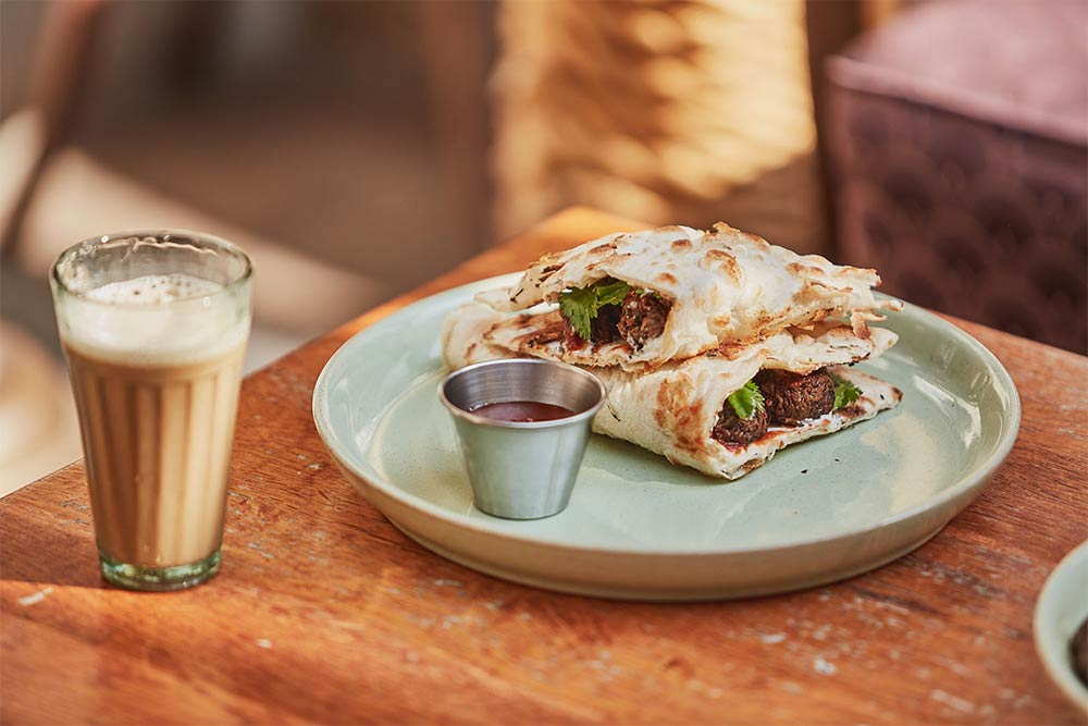 Dishoom launch a vegan version of their naan kit - the vegan sausage naan roll